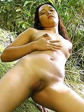 Chubby asian shows her twat outdoor